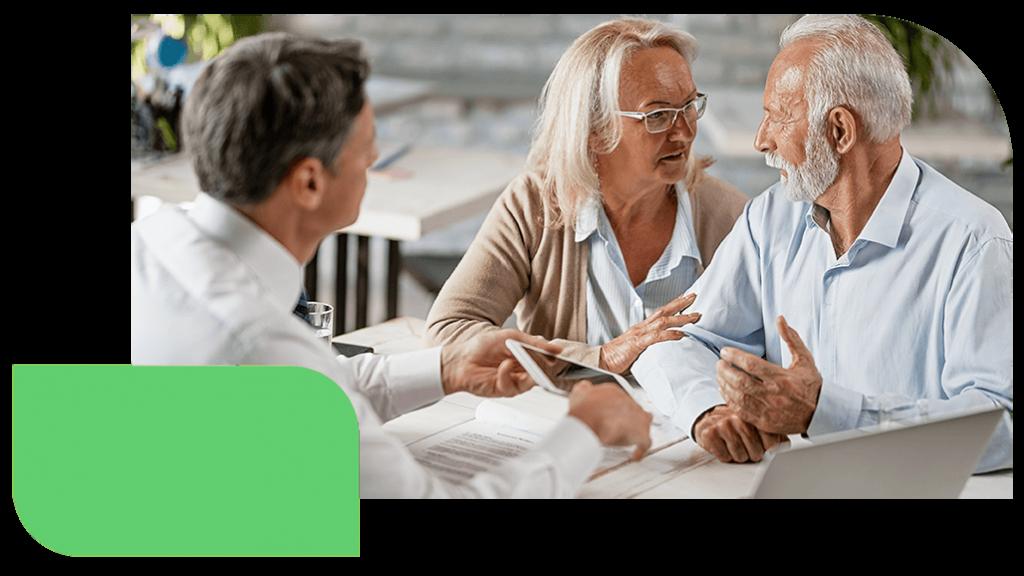 grandparents talking finances with banker